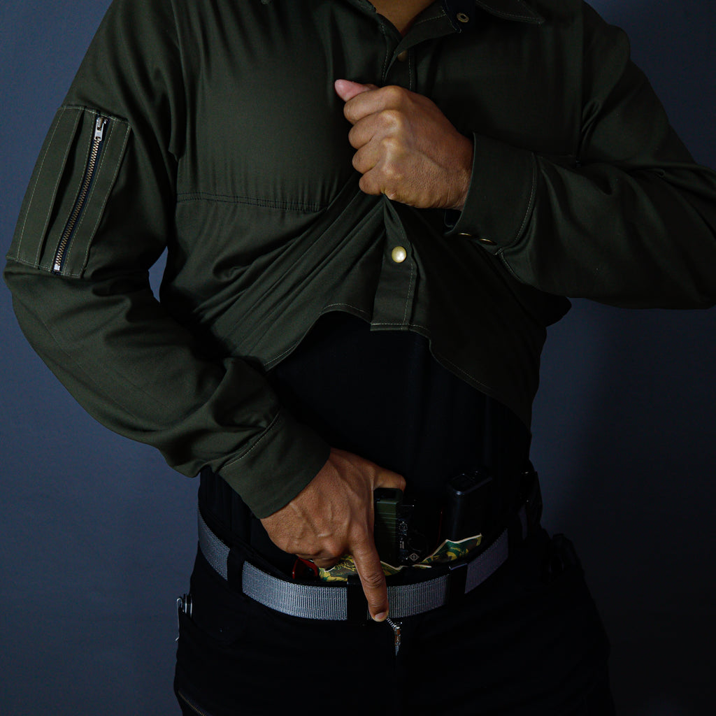 The Urban Warrior Concealed Carry Shirt has a fast dry insert built into it designed to be a moisture management layer between your EDC firearm and your skin. This drastically improves the comfort of concealed carrying while keeping you dry cool and comfortable. The shirt is made from premium materials designed to stretch so that it aids with your concealed carry draw-stroke. It also features a utility pocket enclosed with a YKK zip on the right hand sleeve as well as a chest pocket.