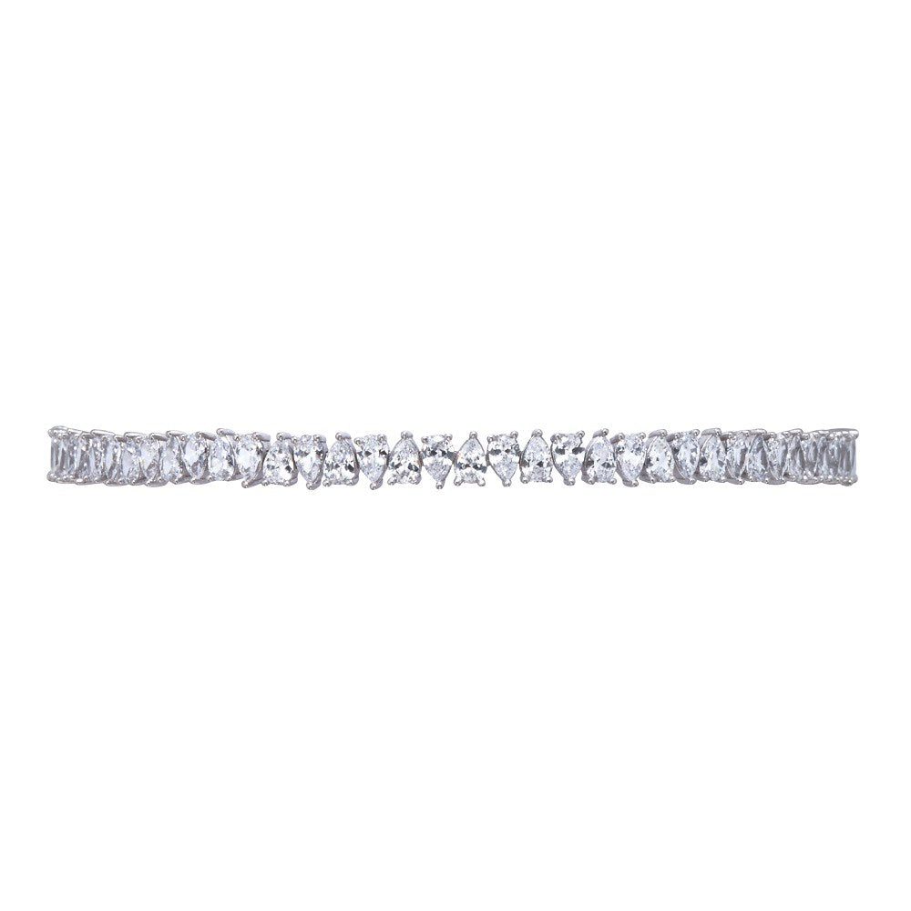 The FALLON Jagged Edge Pear Toggle Choker Necklace in rhodium is made from rhodium-plated brass and cubic zirconia crystal.  Adjustable to any neck size.