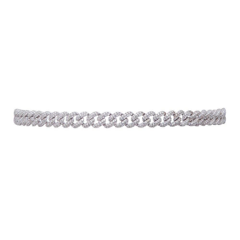 THE FALLON PAVÉ CURB CHAIN CHOKER IS MADE WITH IMITATION-RHODIUM-PLATED BRASS AND AAA HAND-SET CUBIC ZIRCONIA STONES.