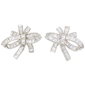 THE FALLON BAGUETTE BOW CLUSTER EARRINGS IN RHODIUM.