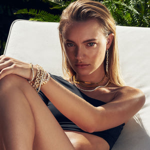 Maya Stepper wearing the FALLON Grace Bracelet in gold.