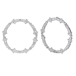The FALLON Jagged Edge Cheekbone Hoops are a celebrity favorite.  Statement hoop earrings made from plated brass and cubic zirconia crystal.