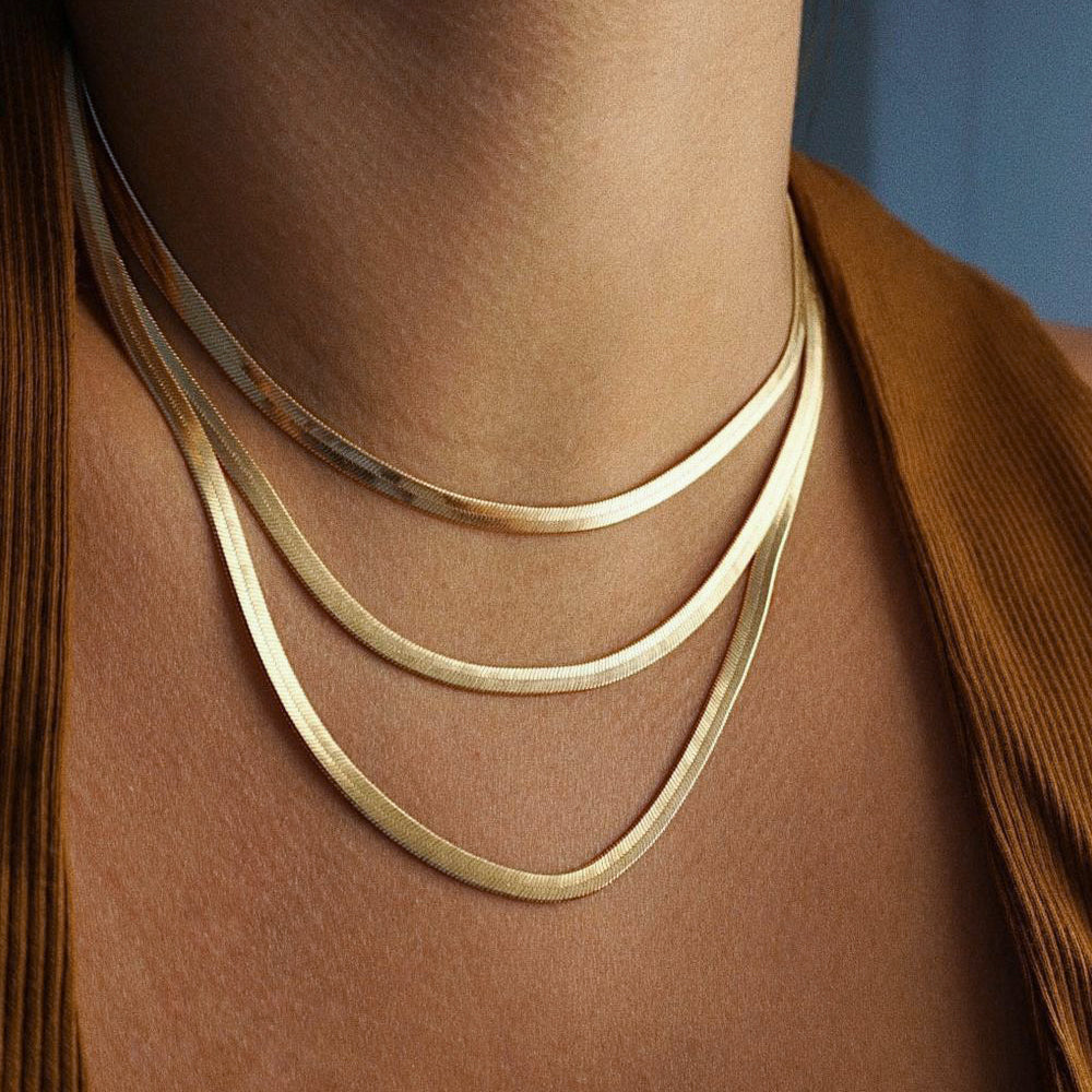 The FALLON Medium Herringbone Chain Necklace in gold plated brass.