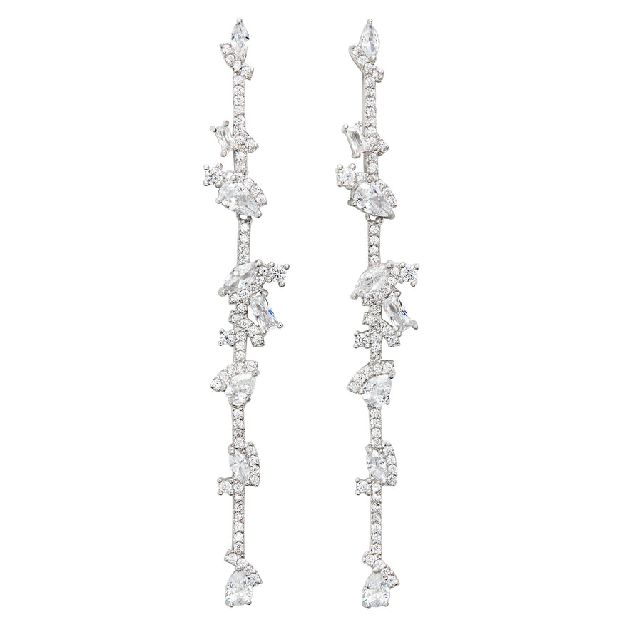 The FALLON JAGGED EDGE BAR DROP EARRINGS are made from plated brass and cubic zirconia.
