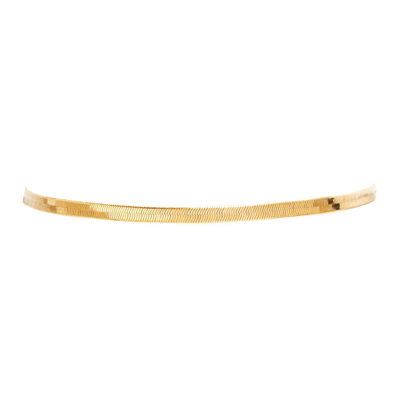 THE FALLON LIQUID HERRINGBONE CHAIN CHOKER NECKLACE IS MADE FROM FINE GOLD-PLATED BRASS.