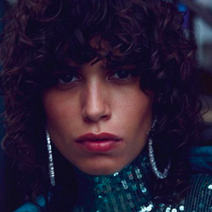 Mica Argañaraz wearing the FALLON Jagged Edge Cheekbone Hoops.