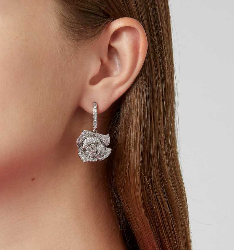 The FALLON Pavé Rose Drop Earrings in rhodium.