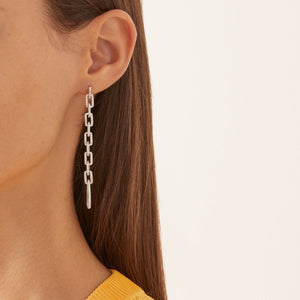 The FALLON Pavé Elongated Link Drop Earrings in rhodium, made from plated brass and cubic zirconia crystal.