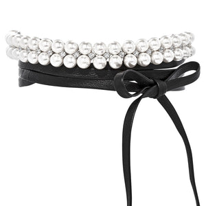 THE FALLON PEARL LEATHER WRAP CHOKER FEATURES GLITTERING AAA CUBIC ZIRCONIA CRYSTALS SHINING BETWEEN TWO LINES OF FINE SHELL PEARLS, ALL SET IN FINE IMITATION-RHODIUM-PLATED BRASS.