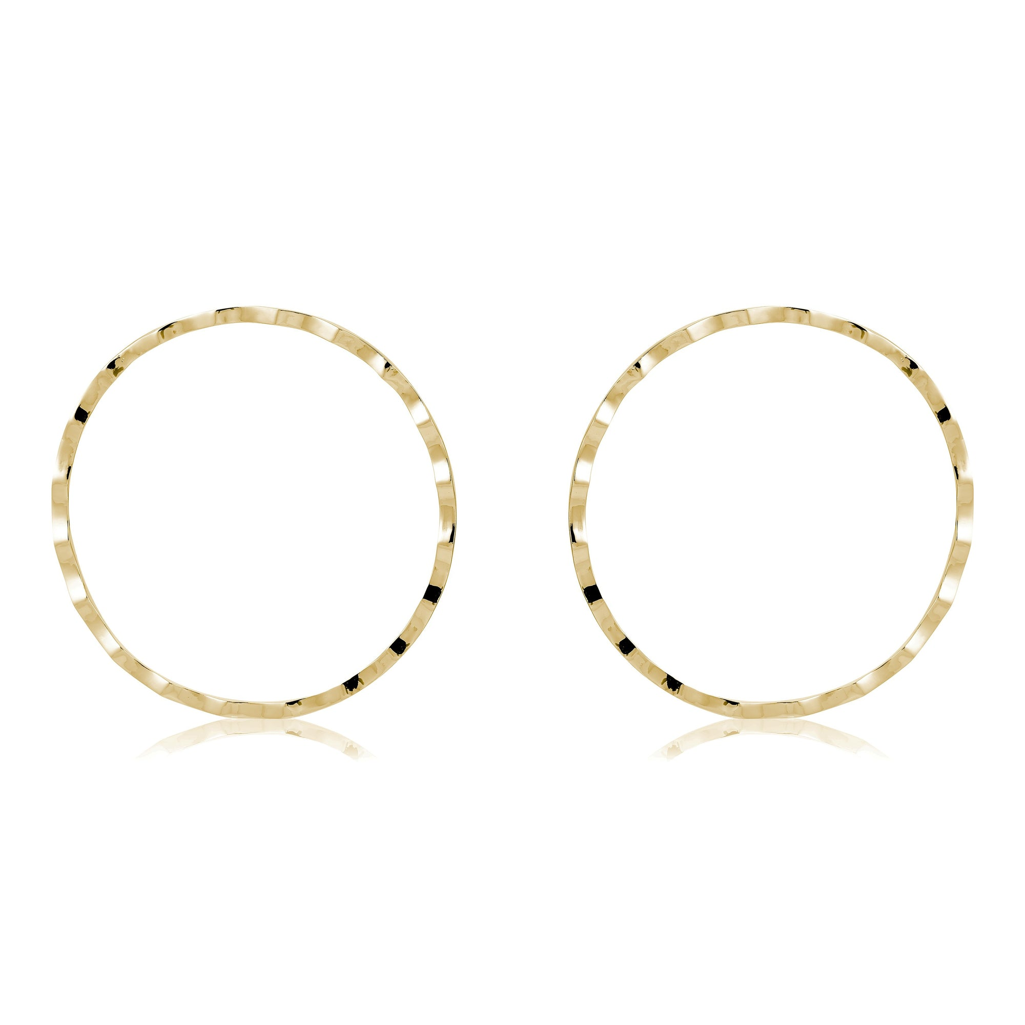 The FALLON Rippled Cheekbone Hoop Earrings in gold.