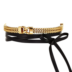 THE FALLON LINK FRONT LEATHER WRAP CHOKER IS MADE FROM GOLD-PLATED BRASS WITH LEATHER TIES.