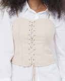 EMBER Lace Up Corset Top in Nude at FLYJANE | SLEEVELESS HOOK AND EYE BOW DETAILED TOP | Nude Corset Top | Cute Kylie Jenner Inspired Corset Top