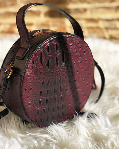 NARNI Ostrich Embossed Round Crossbody Bag in Wine at FLYJANE | Ostrich Crossbody Bag | Wine Burgundy Red Round Bag | Cute Statement Bags at ShopFlyJane.com