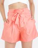 BALTHAZAR Bermuda Shorts in Coral at FLYJANE | Pleated Shorts | Coral Shorts | Summer Fashion  | Cute Outfits at FLYJANE
