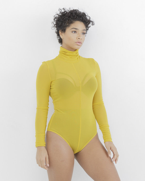 REZY Sheer Mustard Yellow Mock Neck Bodysuit by The Loud Factory at FLYJANE | Mock Neck Sheer Bodysuit under $50 | Kim Kardashian Mustard Yellow Sheer Bodysuit