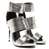 http://www.shopflyjane.com/products/the-blame-game-strappy-sandal-silver THE BLAME GAME Strappy Sandal Silver Heel at FLYJANE | Yanka-34 Sandal | Cute Silver Sandal with Tassel | Follow us on Instagram at @FlyJane