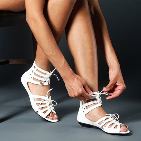 VERCI Lasercut Gladiator Sandals in White at FLYJANE | Cute Thong Sandals | White Sandals | White Sandals | Open Toe Sandals | Cute Sandals under $25 | Shop FLYJANE on Instagram