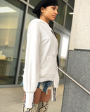 CANNON White Oversized Pullover Sweatshirt at FLYJANE | Cutout Sweatshirt with Sequin Detail | Contemporary Style and Street Style at FLYJANE
