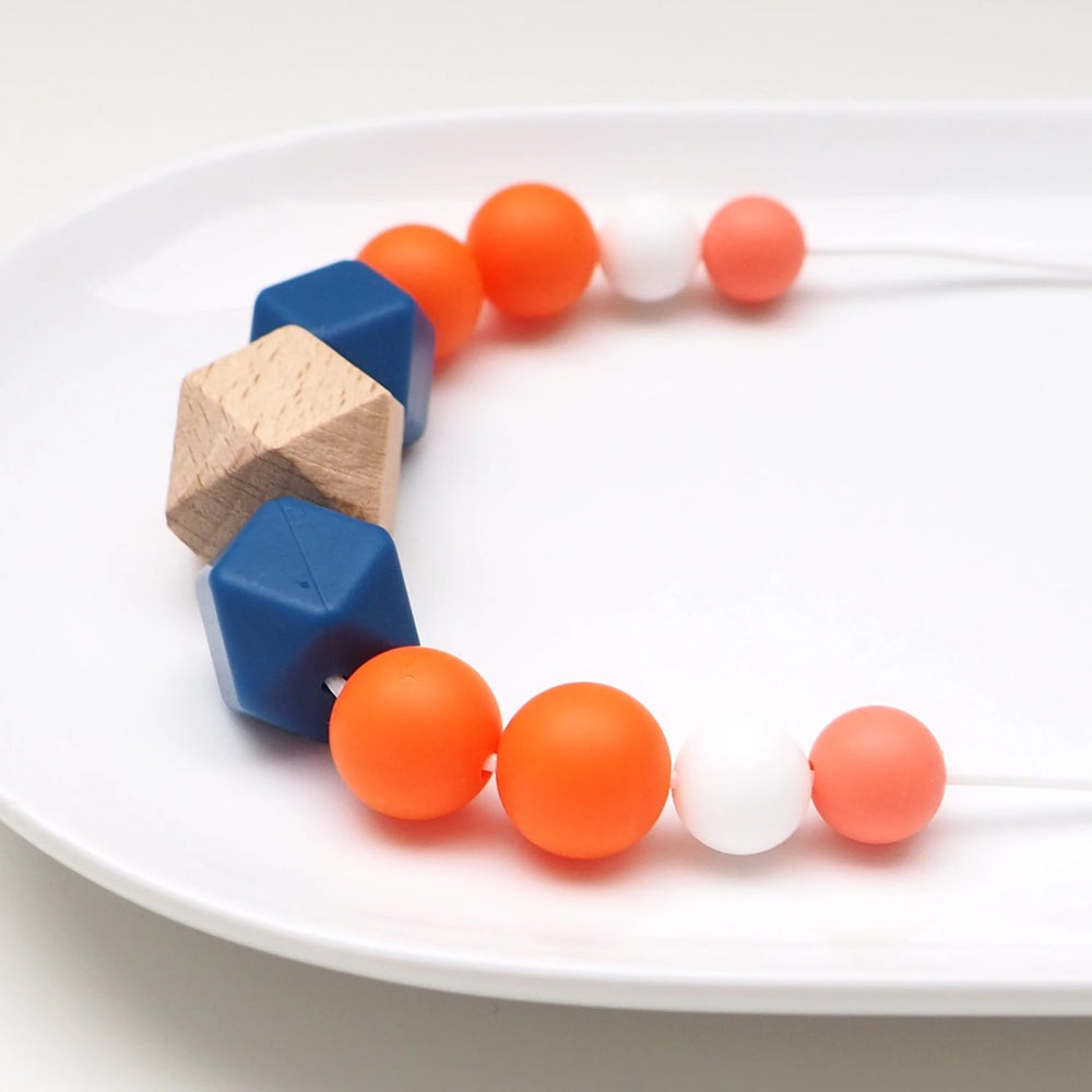 The Wild and The Tame_Colourpop Pink, Orange and Blue Wood and Silicone Teething Necklace_Gift for new mum