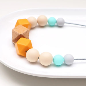 The Wild and The Tame_Neutral Turquoise, Orange and Blue Wood and Silicone Teething Necklace_Gift for new mum