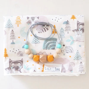 The Wild and The Tame_Neutral Turquoise, Orange and Blue Wood and Silicone Teething Necklace_Gender Neutral Woodland Animal Baby Cot Blanket_Mum and baby gift set