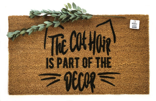 The cat hair is part of the decor doormat