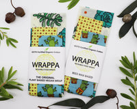 Photo of WRAPPA Wax Wraps with succulent print, on a white background surrounded by native Australian leaves and gum nuts.