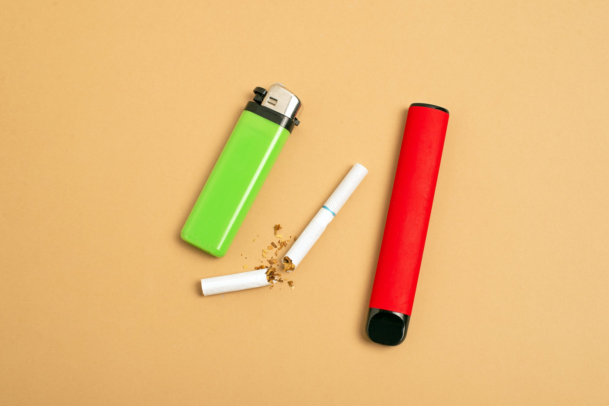 cigarette and disposable vape and lighter