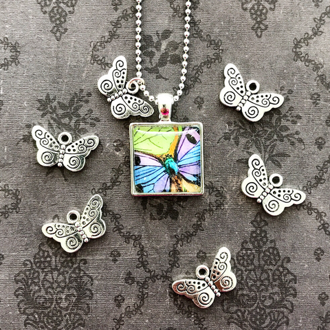 BUTTERFLY KISS CHARM antique silver