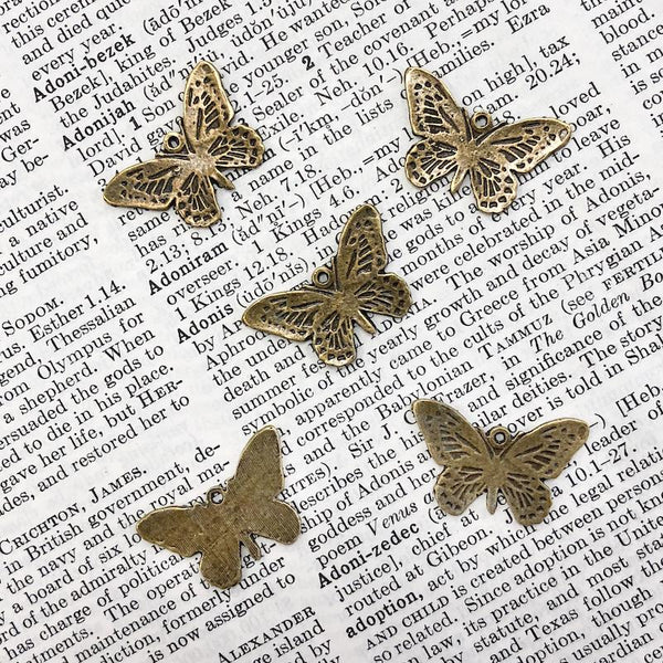 CUT-OUT BUTTERFLY CHARM antique brass