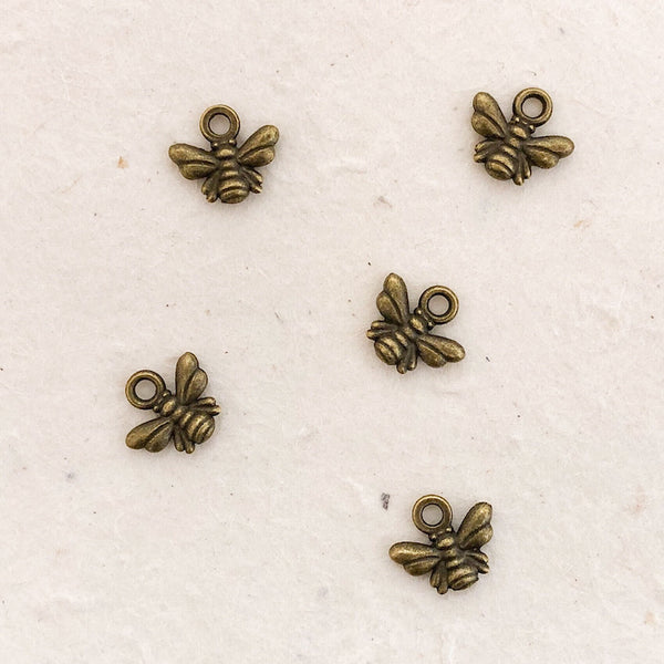 TINY BEE CHARM antique brass