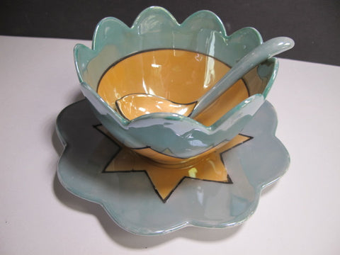 Green and amber bowl with spoon and underplate
