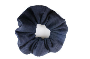 navy sized scrunchie with fine lines on it.