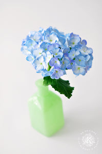 Blue Hydrangeas in Green Milk Glass Vase