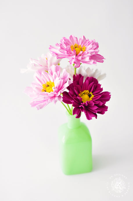 Double Cosmos Flowers in Green Milk Glass Bud Vase