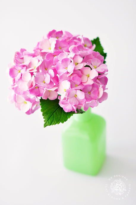 Pink Hydrangeas in Green Milk Glass Vase
