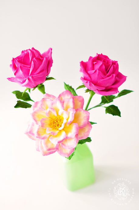 Shrub Rose with Fuschia Pink Tea Roses in Green Milk Glass Vase