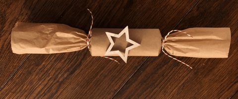Brown paper wrapped snapping cracker.