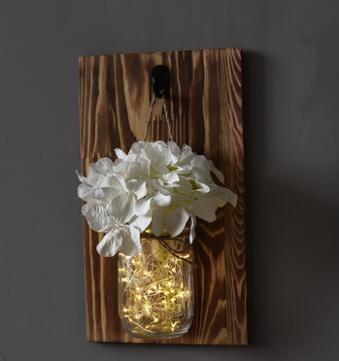 mason jar with lights and white flowers