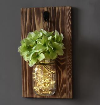 rustic mason jars with lights and green flowers