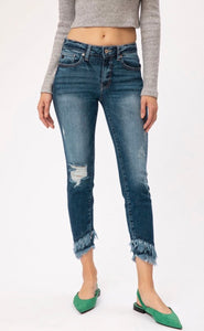 Dark wash cropped skinny jeans with frayed hem detail