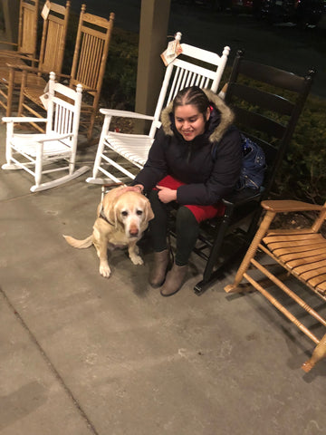 This is a photo of Aziza Rodriguez and her service dog.