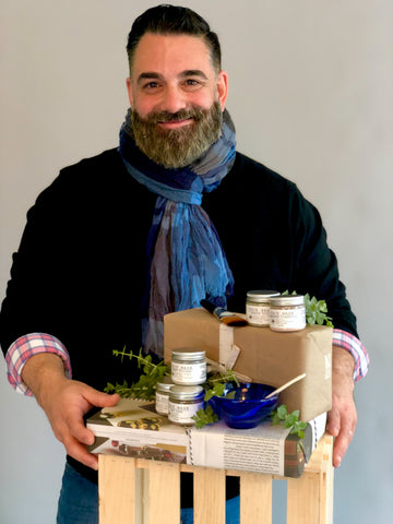 Christopher Cieri of Franklin & Whitman, holding his products