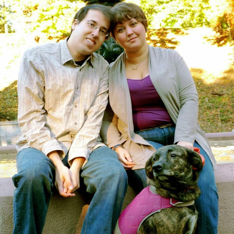 This is a photo of Samantha Beeley with her husband and service dog.