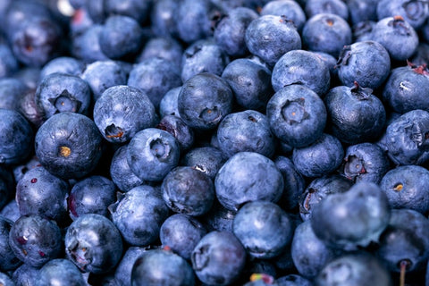 This is an image of blueberries. There are a lot of them. There is nothing else in the photo, not even a background.