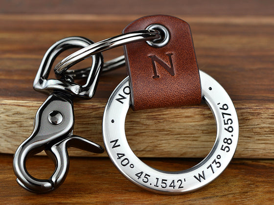 3rd Anniversary Leather Keychain with Your Initial. Engrave the coordinates of where you got married with your initial embossed into leather to celebrate your 3 years together.