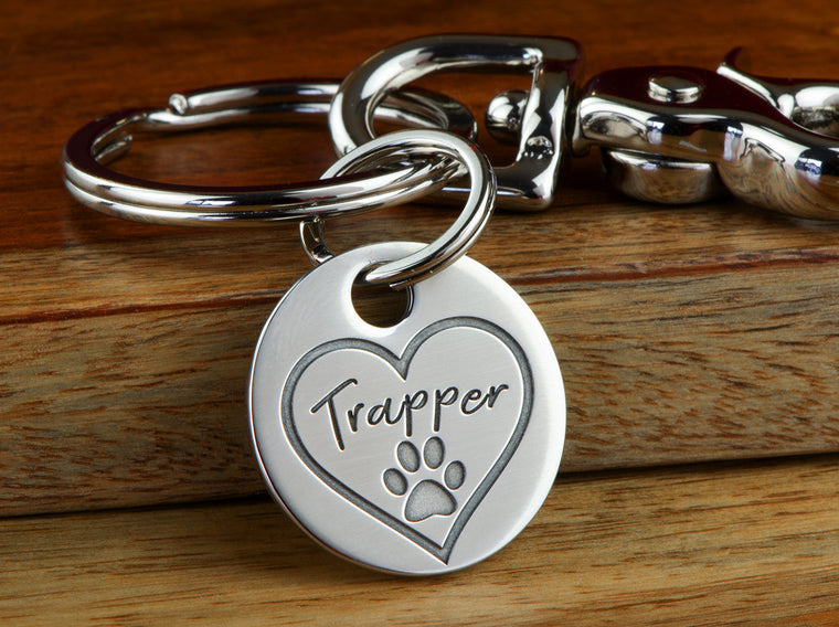 Pet memorial remembrance keychain with paw print and name of beloved pet