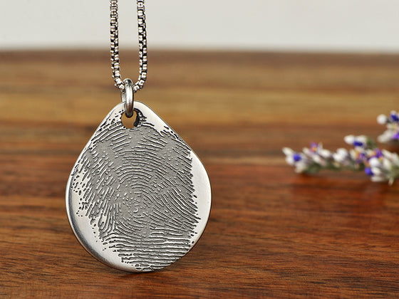 Thumbprint pendant necklace engraved with your actual fingerprint. Perfect gift to have someone special close to you or a memorial gift for a family member.