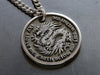 Custom engraved stainless pendant with raised engraving of dragon and custom saying of your choice