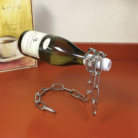 Chain suspension wine bottle holder by Invisible Threads